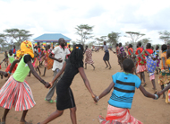 Adolescent girls and boys play games at a Child Frieldly Space in Amudat District.